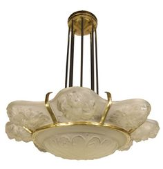 "Sabino Flower Chandelier  This stunning French art deco chandelier from the 1930's was designed by the glass master Marius-Ernesto Sabino. Eight panels of flower motif embrace the center coupe in etched acid with polished details and held by a bronze wavy fixture with eight rods. All glass panels are signed ""SABINO"" FRANCE.  Circa 1930's"