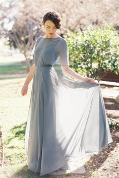 You will be ready for your close-up with an illusion feel on this flutter sleeve chiffon grey skirt. With a lace-up running across your bare back, you will have a svelte bodice in this low V-back corset back long prom dress.
