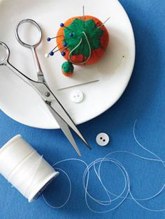 How to Hand Sew a Button - Free Sewing Tips at WomansDay.com - Woman's Day