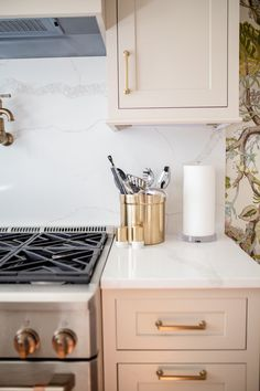 A Southern Transitional kitchen design via Glitter & Gingham // How to modernize kitchen wallpaper // Off white cabinets // Schumacher Wallpaper // Colorful home decor // Ft. Cafe Appliances