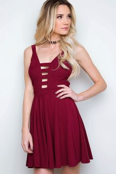 - Details - Size Guide - Model Stats - Contact Put your heart and soul into fashion! This burgundy Harley Skater Dress features a thick, knit fabric with stretch. Deep, V-neck front with ladder design