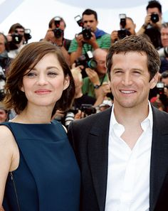 Marion Cotillard and Guillaume Canet attend the photocall for 'Blood Ties' at The 66th Annual Cannes Film Festival on May 20, 2013