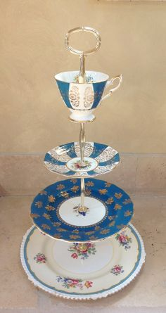 4 tier cake stand Teal Blue and Gold for by HelensRoyalTeaHouse, $130.00  https://www.etsy.com/shop/HelensRoyalTeaHouse?ref=listing-shop-header-item-count