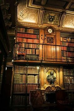 The Library of Chantilly in France is absolutely stunning! Love the lighting, the clock, the designs on the walls, and of course, the two stories filled w/ books!