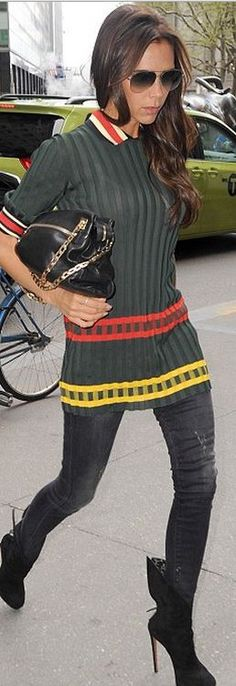 Victoria Beckham: Sweater – Celine  Sunglasses and purse – Victoria Beckham Collection  Jeans – R13  Shoes – Alaia
