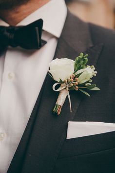 classic boutonniere + groom look, photo by Christine Lim http://ruffledblog.com/glam-toronto-hotel-wedding #boutonnieres #grooms