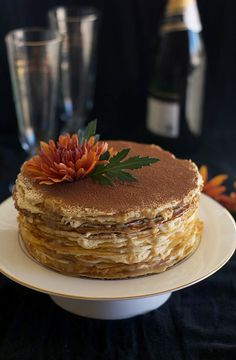 Recipe for Tiramisu Crepe Cake with a White Chocolate Espresso Ganache. Festive, impressive-looking, deceptively easy.