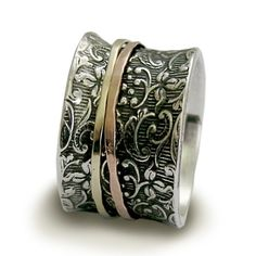 R1209A  Wonderful Sterling Silver Ring with 9K Yellow and Rose Gold Spinners. Main band is floral pattern oxidized sterling silver .The special