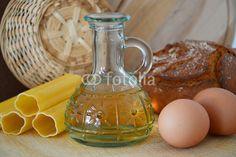 oil bottle, bread, eggs, pasta and a small wicker basket