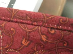 Decorative stitching on quilt bindings