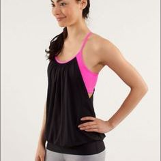 Lululemon workout tank Gray Lululemon workout tank with pink bra. This workout shirt has a built-in bra and is very secure. Size 4 lululemon athletica Tops