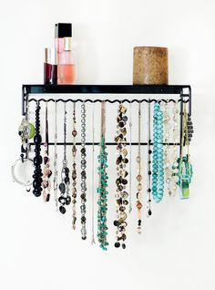 I really want to make something like this.  Amazon.com - Wall-Mounted Jewelry Organizer - Necklace, Earring, Bracelet, Ring Holder - Jewelry Boxes
