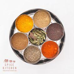 Indian Spice Tin with 11 spices including 40g Tandoori Masala Each order contains 10 high quality Spices:  Tandoori Masala (40g) Cardomon (10 pieces) Cloves (10 pieces) Cinnamon Sticks (5 pieces) Kashmiri Chilli Powder (20g) Cumin Seeds (20g) Ground Coriander (20g) Spice Kitchen Garam Masala (20g) Mustard Seeds (20g) Turmeric Powder (20g) Home Grown Curry leaves (2g)