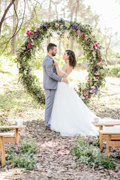 Giant Floral Wedding Ceremony Wreath for a stunning outdoor wedding ceremony in a forest!  http://www.confettidaydreams.com/giant-floral-wedding-ceremony-wreath/  Pics: Nicola Bester Photography