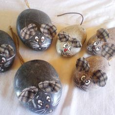 Katerina Tsaglioti Decorated Rocks - using fabric for ears is a cute idea