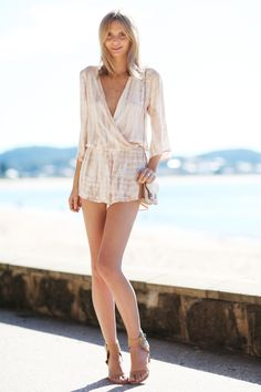Romper by Blue Life, wallet by Proenza Schouler, sandals by Jeffrey Campbell. (tuulavintage.com, June 20, 2014)