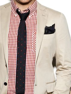 Beige jacket, red gingham shirt, navy knit tie with red pin dots