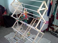 Laundry Rack Bird Jungle Gym - petdiys.com this is so cool and rather inexpensive. Gonna make everything out of laundry racks lol.