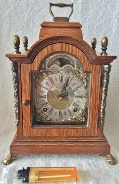 Low bids now on eBay this Beautiful Warmink 8 Day 9.4 Inch Oak Wood Bracket Clock With Rolling Moon Phase