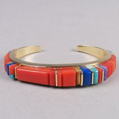 Charles Loloma cuff bracelet. 14k gold, coral, sugilite, turquoise, fossilized ivory and lapis lazuli inlay.