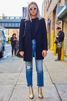 shoes nyfw 2017 fashion week 2017 fashion week streetstyle denim jeans blue jeans ripped jeans boots gold boots ankle boots metallic metallic shoes pointed boots coat black coat sweater black sweater sunglasses bag black bag winter outfits winter look Fashion Mode, Star Fashion, Look Fashion, Daily Fashion, Petite Fashion, Curvy Fashion, Winter Fashion, Fashion Outfits, Gold Ankle Boots