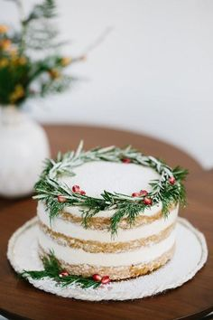 The rosemary and pomegranate seeds on this gorgeous cake are a chic way to incorporate traditional holiday colors. The rosemary and pomegranate seeds on this gorgeous cake are a chic way to incorporate traditional holiday colors. Holiday Cakes, Holiday Treats, Christmas Treats, Holiday Recipes, Christmas Recipes, Noel Christmas, Christmas Goodies, Christmas Desserts, Modern Christmas