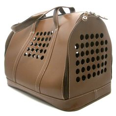 This sophisticated carrier offers both style and practicality. The Carrier 1 is made from recycled materials and airline approved. #dogonthego
