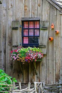 Faux shutters attached to all chalets with window boxes - flowers planted…