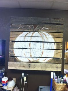 Pumpkin painting on an old pallet.
