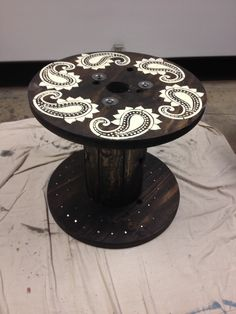 Electrical spool table. Stained and used a stencil for the top.