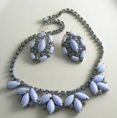 Beautiful baby blue milk glass and rhinestone necklace and matching clip earrings. All stones are present, prong set in silver tone and are