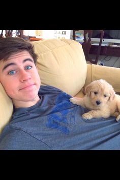 I want that puppy!!!! :) it's sooooo cute!!!! Don't know who that person is and don't care. Lol