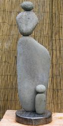 "*""Mother and Child"" A three-foot river rock sculpture."