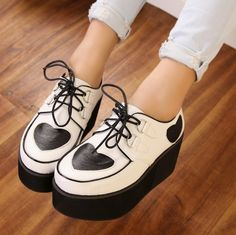 I want a pair of creepers so bad.  preferably these :)