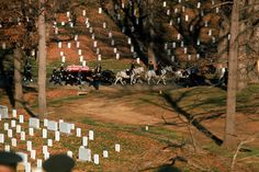 """JFK funeral : Caption from LIFE, """"With the sound of creaking wheels and clattring hoofs breaking the silence, the President's caisson entered Arlington Cemetery, passed the graves of American war heroes and headed toward the burial spot on a grassy hill which looks over the Potomac."""""""