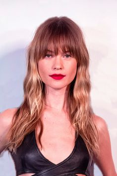 Yes, models can pretty much make anything look good, but Behati's beachy waves and feathered fringe combo has us reaching for our scissors (jk, we'd never try to cut our own hair, but it does have us reaching for our phone to call our stylist).