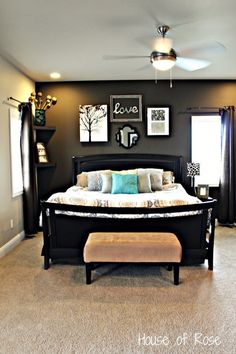 This is EXACTLY what I wanted to do with our Master Bedroom. It's HUGE and I think the charcoal wall would look great! I also love the splashed of blue.