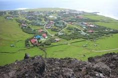 Tristan da Cunha. The archipelago has a wet oceanic climate with pleasant temperatures but consistent moderate to heavy rainfall and very limited sunshine. The number of rainy days is comparable to the Aleutian Islands at a much higher latitude in the northern hemisphere, while sunshine hours are comparable to Juneau, Alaska 20° further from the equator. Frost is unknown below altitudes of 500 metres (1,600 ft) and summer temperatures are similarly mild, never reaching 25 °C