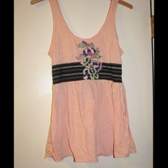 Free People peach, embroidered top. Peach colored embroidered top. Old product but in good condition.                                       Reasonable offers welcome (please use offer button) Free People Tops Tank Tops