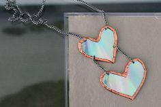 12.) A Pendant - Use your old CDs to make personalized prism pendants