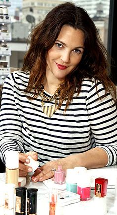 I like Drew Barrymore's hair color, make-up, and striped shirt with a statement necklace.