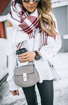 Black pants, white shirt, and a red and white blanket scarf. Adorable outfit for winter!