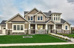 Clark and Co. Homes Contemporary Craftsman for the Boise Spring 2014 Parade of Homes. Exterior paint color is Benjamin Moore Graystone with White Dove trim and Echo Ridge Country Ledgestone.