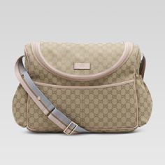 PARENTING GONE MAD: GUCCI DIAPER BAG. Apart from the fact that a girl can't have too many Gucci bags, it is a very well designed nappy bag for women on the go. I want this