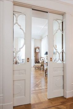 Love these hidden closet doors with the glass design