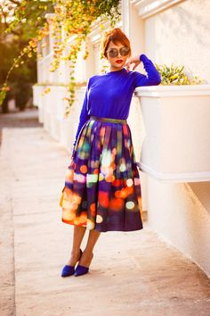 It's that skirt again! Indian Streetstyle Fashion: chicwish-neon-light-pleated-midi-skirt with a cobalt sweater and Oversized sunglasses