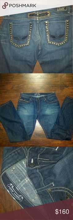 NWOT- Robin's Jean sz 38 blue w/ blk rivet pockets Robin's Jean size 38 blue jeans with black leather rivet pockets and signature wings. Brand new and 100% authentic straight from the manufacturer. Robin's Jean  Jeans Relaxed