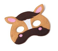 This is a super cute felt kids mask. These are great for Halloween, costume parties, everyday dress up and they make wonderful party favors as well. Children have so much fun with our masks letting their imaginations run wild. Every kid loves pretend play and now you can help your child