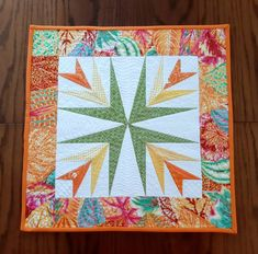 Patchwork quilted table topper, modern and original design, orange, yellow and green on white