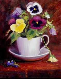 pansies in tea cups and tea pot